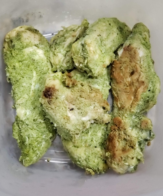 Chicken tenders cooked with green tandoori paste