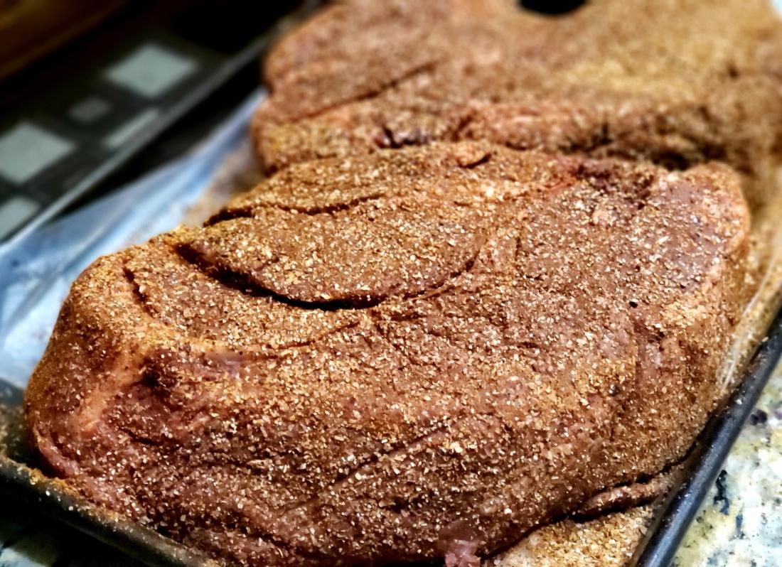 Chuck roast coated with rub